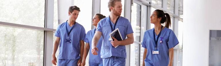 hospital staff walking through hallway