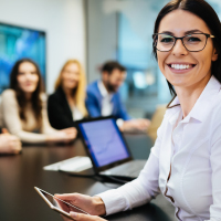 professional woman smiling at conference table